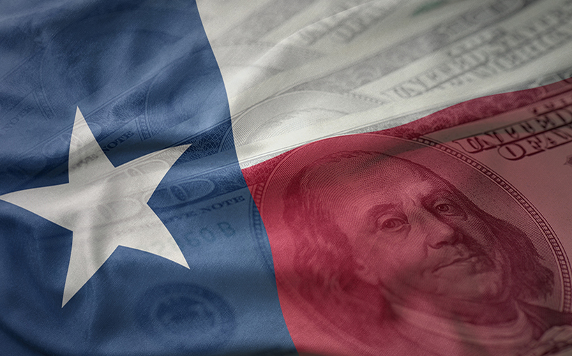 colorful waving flag of texas state on a american dollar money background. finance concept